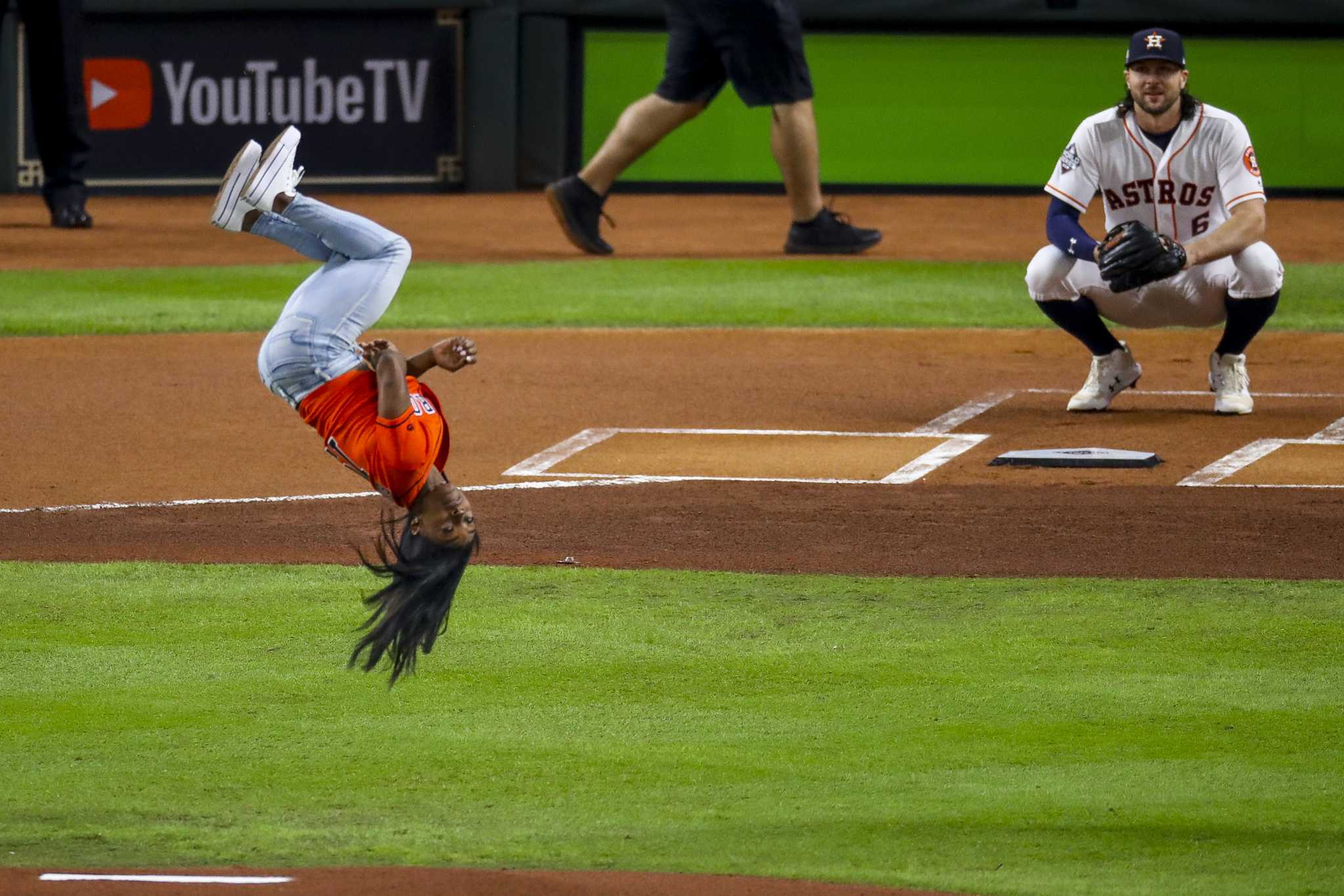 Simone Biles pulls off standing back flip with twist before World Series first pitch