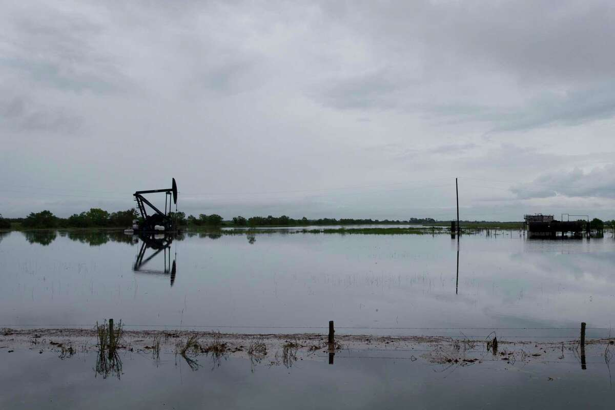 An oil pumpjack sits in the flooded fields on Texas Highway 65 on Thursday, Sept. 19, 2019, in Monroe City during Tropical Storm Imelda.