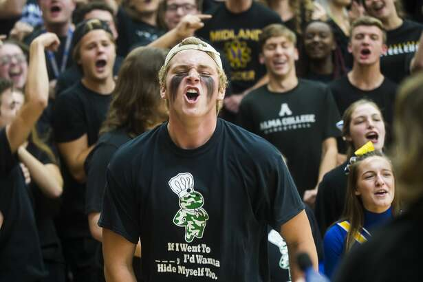 """Midland High School students, dressed in different colors for each grade level, compete in games during the """"Yell Night"""" pep rally Wednesday, Oct. 23, 2019 at the school. (Katy Kildee/kkildee@mdn.net)"""