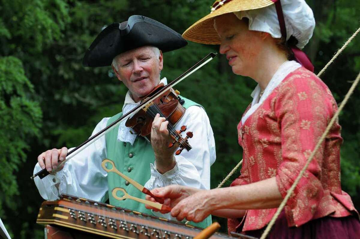 Ridley Enslow of Hoboken, N.J., plays a violin made in France in 1776 and his wife, Anne, plays a hammered dulcimer during the 18th Century Day at the Historic Schuyler House in Schuylerville on Sunday, Aug. 8, 2010. ( Philip Kamrass / Times Union )