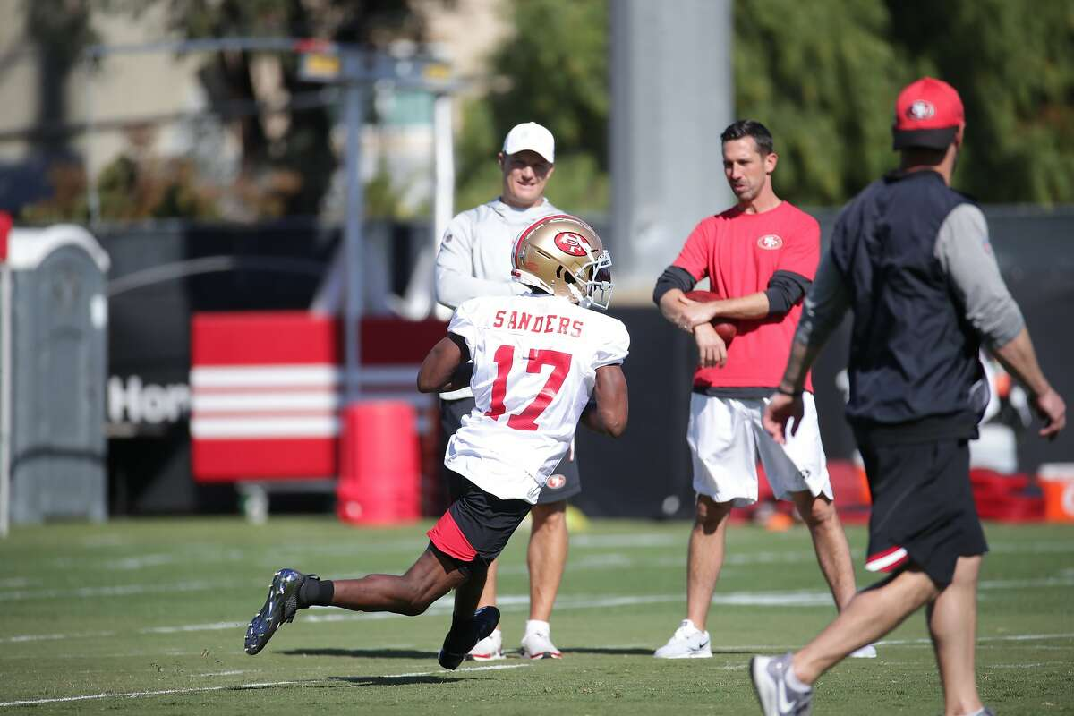 San Francisco 49ers Wide Receiver Emmanuel Sanders (#17) participates in his first practice as 49ers Head Coach Kyle Shanahan (back right) and 49ers General Manager John Lynch (back let) look on at the 49ers training facility at Levi's Stadium in Santa Clara, Calif. on Wednesday, October 23, 2019.