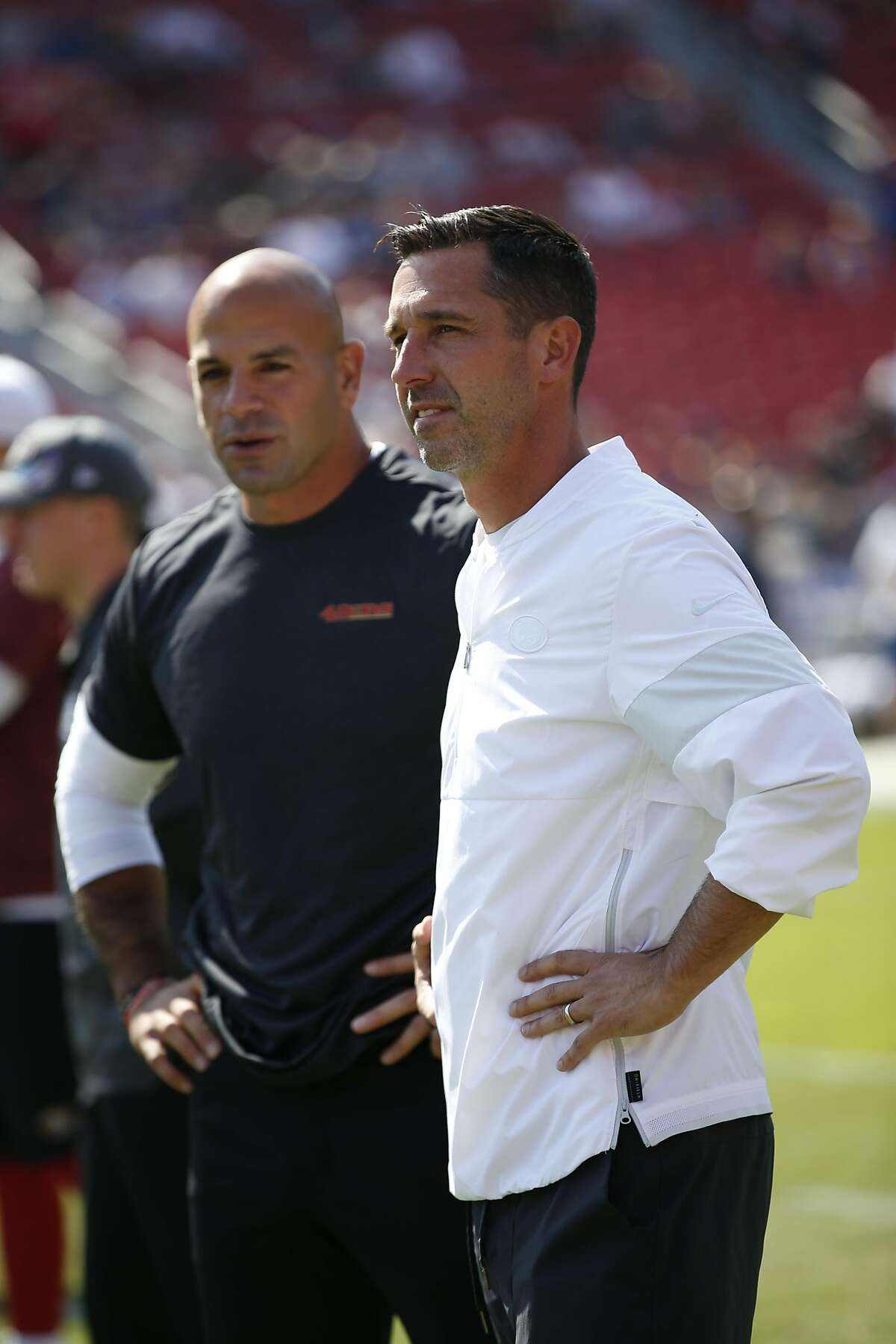 LOS ANGELES, CA - OCTOBER 13: Defensive Coordinator Robert Saleh and Head Coach Kyle Shanahan of the San Francisco 49ers stand on the field prior to the game against the Los Angeles Rams at the Los Angeles Memorial Coliseum on October 13, 2019 in Los Ange