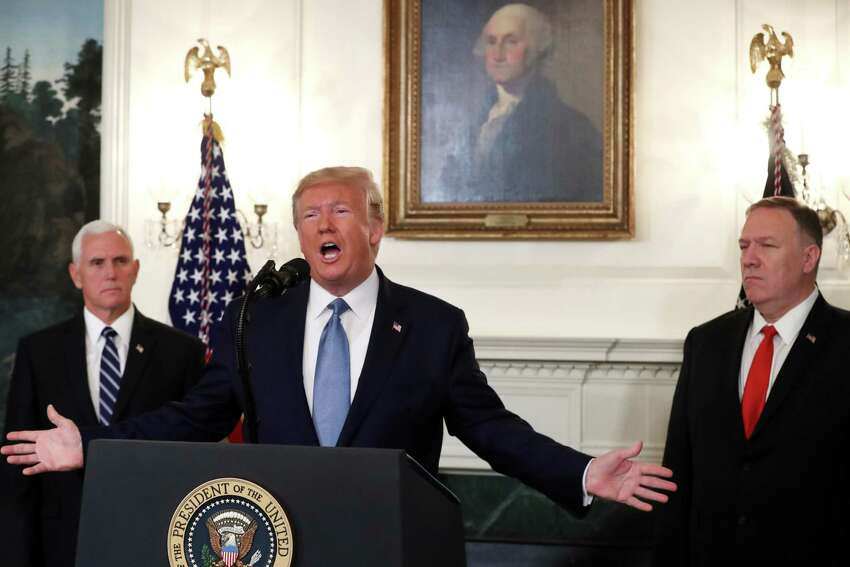 WASHINGTON, DC - OCTOBER 23: U.S. President Donald Trump is flanked by Vice President Mike Pence (L), and Secretary of State Mike Pompeo (R), while making a statement in the Diplomatic Room at the White House, on October 23, 2019 in Washington, DC. President Trump announced that the U.S. would be lifting all sanctions imposed on Turkey in response to their invasion of northern Syria. (Photo by Mark Wilson/Getty Images) *** BESTPIX ***