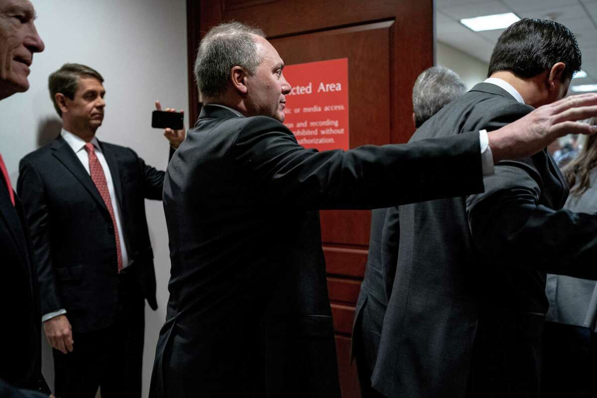 ** RETRANSMISSION TO ADD ID ** Rep. Steve Scalise (R-La.) and other House Republicans walk into the secure room where House impeachment investigation interviews are taking place on Capitol Hill in Washington on Wednesday, Oct. 23, 2019. (Erin Schaff/The New York Times)
