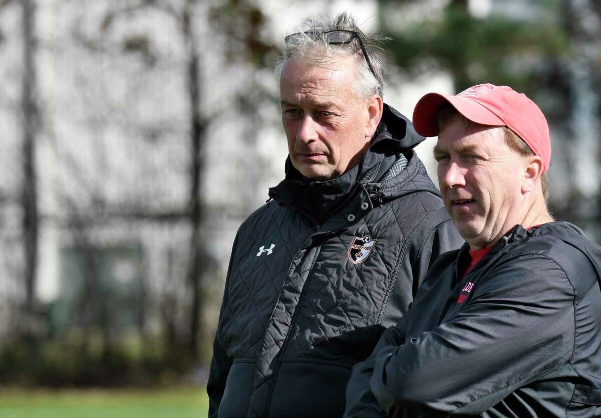 Ballston Spa head coach Garry Preece, left, and Guilderland head coach Mike Kinnally talk before the start of a Section II boys' soccer game Wednesday, Oct. 23, 2019, in Guilderland N.Y. (Hans Pennink / Special to the Times Union)