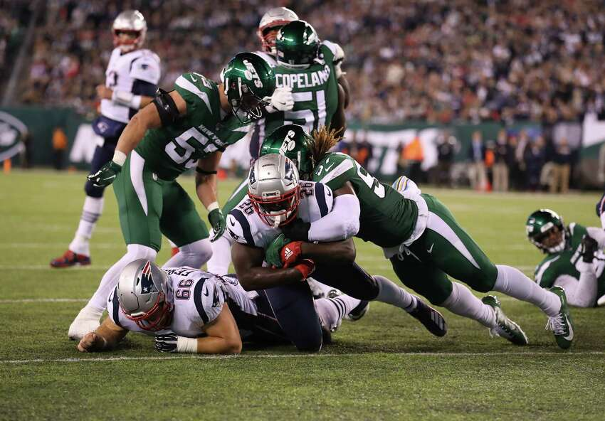 EAST RUTHERFORD, NEW JERSEY - OCTOBER 21: Sony Michel #26 of the New England Patriots scores a touchdown against C.J. Mosley #57 of the New York Jets in the second quarter during their game at MetLife Stadium on October 21, 2019 in East Rutherford, New Jersey. (Photo by Al Bello/Getty Images)