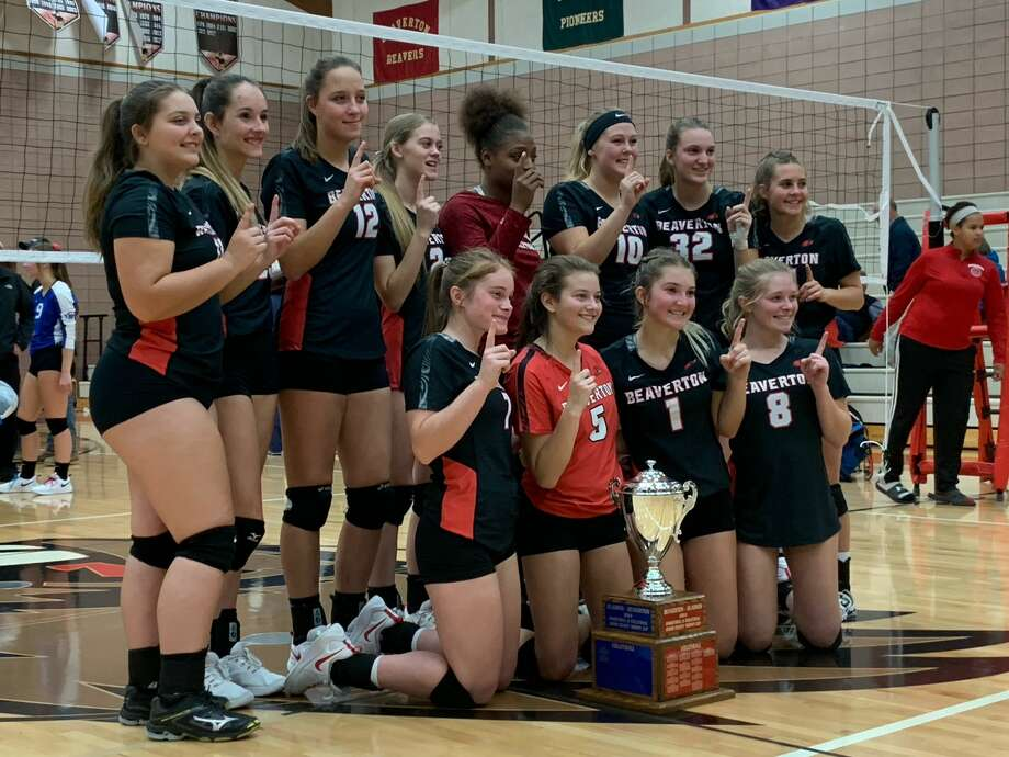 Beaverton's volleyball team poses for photos following Wednesday's big sweep of Gladwin. Photo: Fred Kelly/fred.kelly@mdn.net