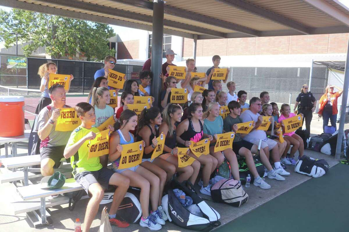 Deer Park tennis coach Tommy Heim (front row) and his team tennis players display their