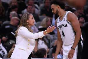 San Antonio Spurs assistant coach Becky Hammon gives advice to guard Derrick White during NBA action against the New York Knicks in the AT&T Center on Wednesday, Oct. 23, 2019.