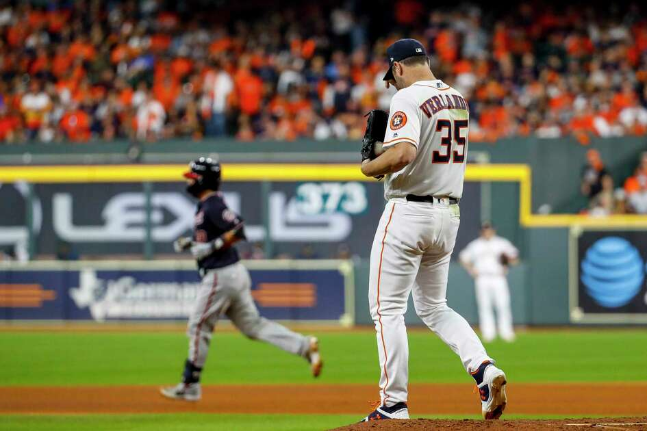 Houston Astros starting pitcher Justin Verlander (35) reacts after giving up a home run to Washington Nationals catcher Kurt Suzuki (28) during the seventh inning of Game 2 of the World Series at Minute Maid Park in Houston on Wednesday, Oct. 23, 2019.