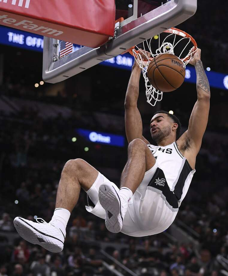 San Antonio Spurs forward Trey Lyles dunks during first-half NBA action against the New York Knicks in the AT&T Center on Wednesday, Oct. 23, 2019. Photo: Billy Calzada, Staff Photographer