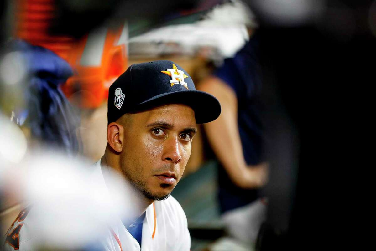Houston Astros left fielder Michael Brantley (23) watches from the dugout during the ninth inning of Game 2 of the World Series at Minute Maid Park in Houston on Wednesday, Oct. 23, 2019.