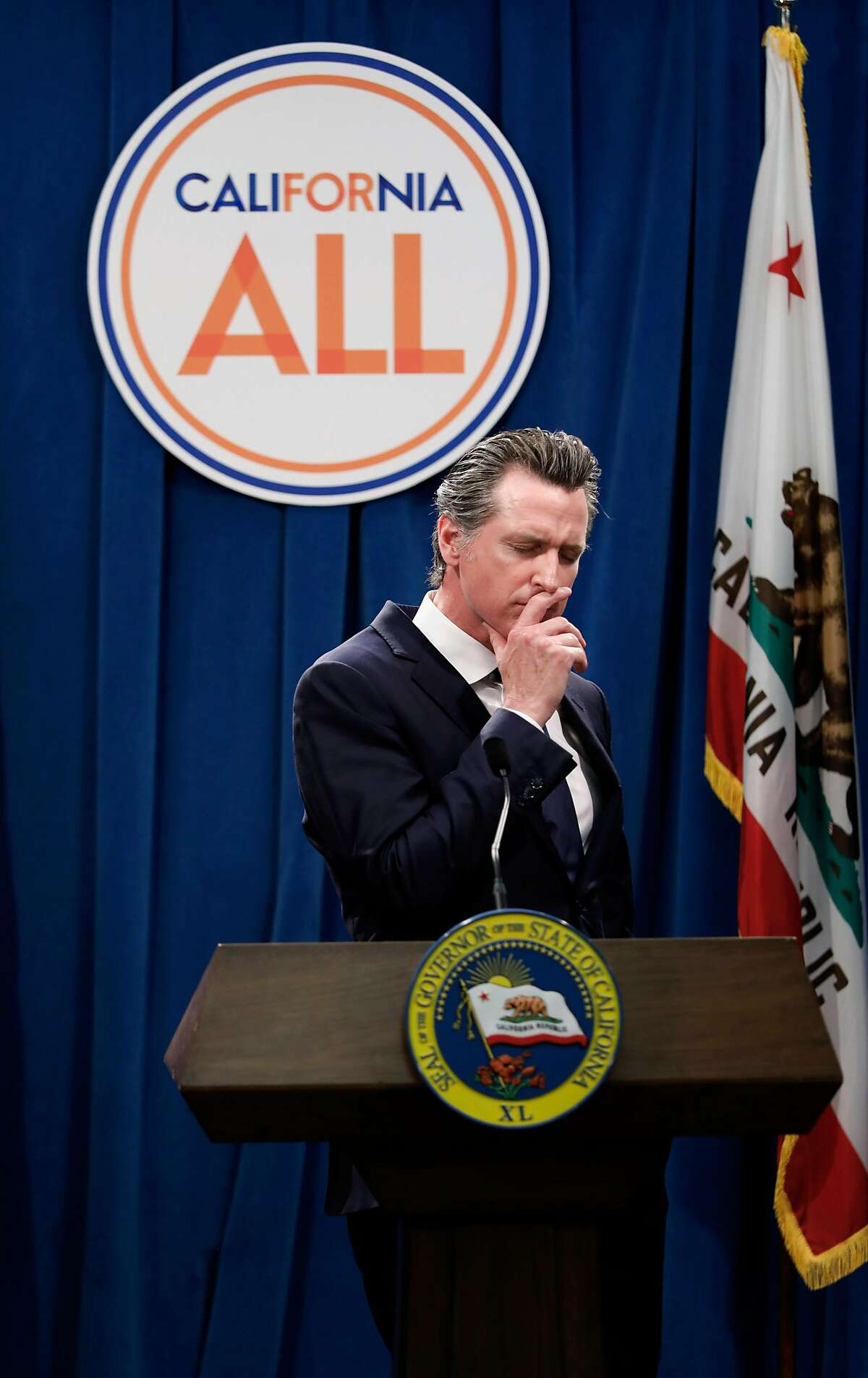 California Governor Gavin Newsom stops during a question from the media, as he releases details of his revised state budget for fiscal 2019-2020 during a press conference at the State Capitol on Thursday. May 09, 2019, in Sacramento, Ca.