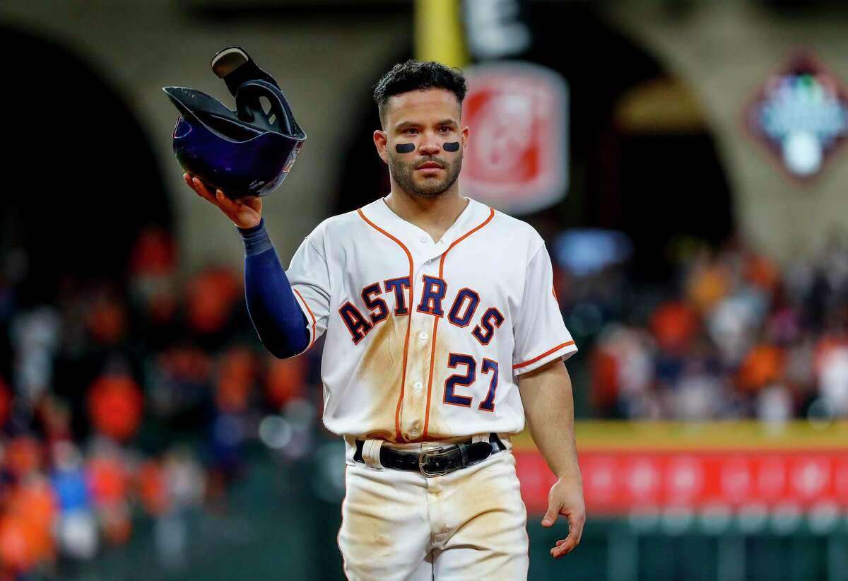Houston Astros second baseman Jose Altuve (27) walks back to the dugout after the Astros 12-3 loss during Game 2 of the World Series at Minute Maid Park in Houston on Wednesday, Oct. 23, 2019.