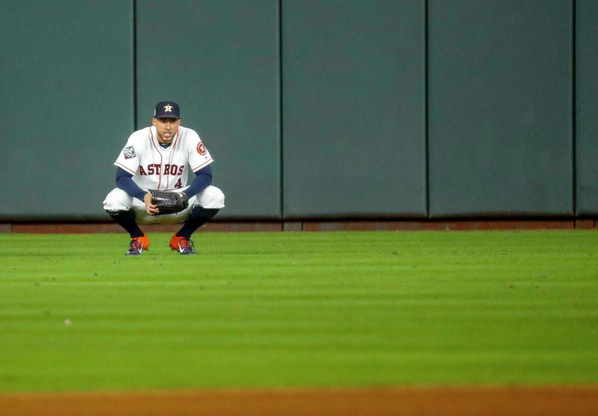 Houston Astros center fielder George Springer (4) waits in center field for the beginning of the eighth inning of Game 2 of the World Series at Minute Maid Park in Houston on Wednesday, Oct. 23, 2019.