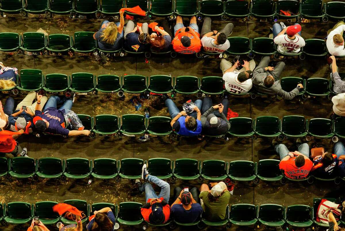 Fans watch the final innings of Game 2 of the World Series at Minute Maid Park in Houston on Wednesday, Oct. 23, 2019.