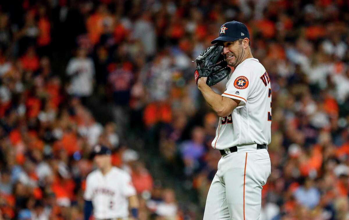 Houston Astros starting pitcher Justin Verlander (35) reacts after giving up a home run to Washington Nationals catcher Kurt Suzuki (28) to give the Nationals a 3-2 lead during the seventh inning of Game 2 of the World Series at Minute Maid Park in Houston on Wednesday, Oct. 23, 2019.