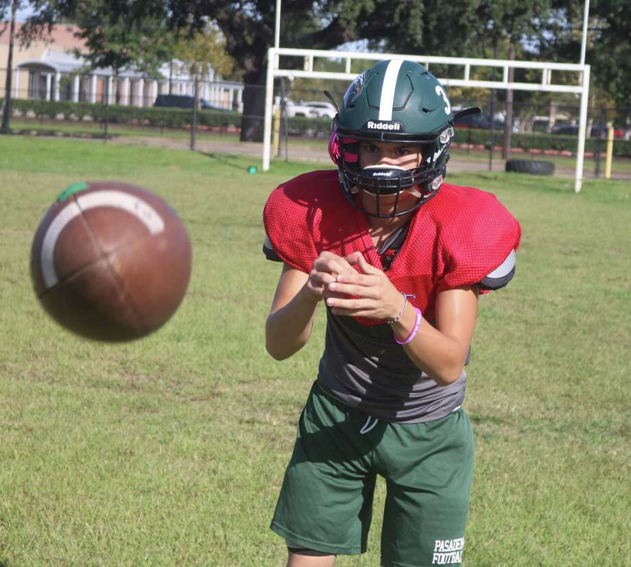 Reserve quarterback Ethan Hernandez takes a snap from center during workouts this week. Pasadena's likely starting quarterback next year,  the coaching staff has worked him in whenever they can this season. Photo: Robert Avery