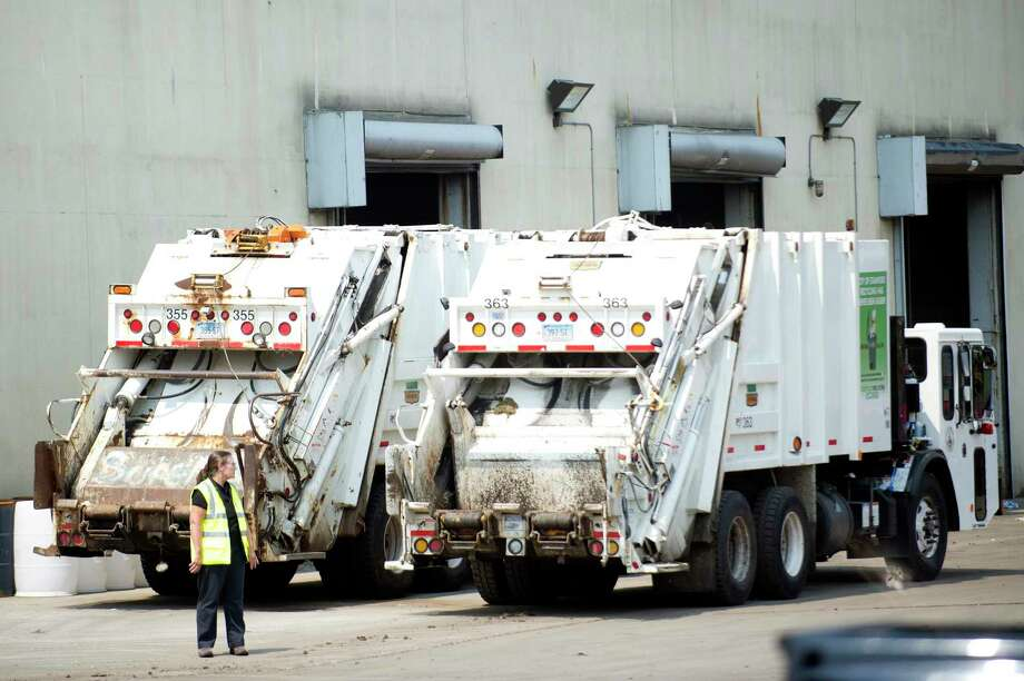 Garbage trucks sit waiting to be filled at the Stamford Transfer Station on Harborview Avenue in 2018. Photo: Hearst Connecticut Media / Stamford Advocate