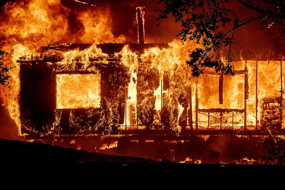 Flames consume a home as the Kincade Fire tears through the Jimtown community of Sonoma County, Calif., on Thursday, Oct. 24, 2019. (AP Photo/Noah Berger) Photo: Noah Berger, Associated Press