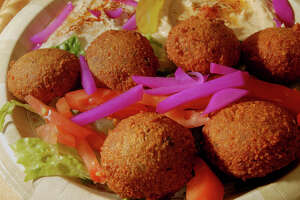Beauty shot of the Falafel dinner served at the Beirut Restaurant specializing in Lebanese Cuisine, on  Thursday, Sept. 3, 2009, on River St. in Troy, NY's antique district.  It features, Chickpea patties, served on a bed of lettuce, tomato, turnip, pickles, and tahini sauce.