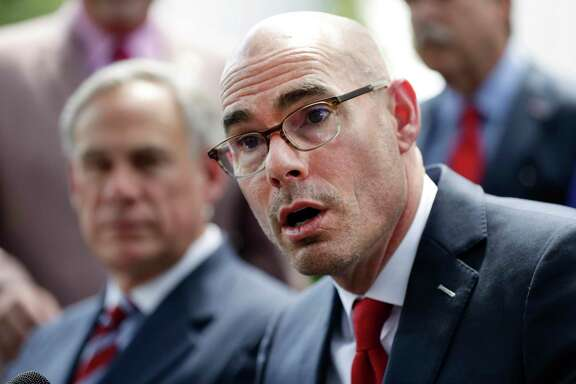 """FILE - In this May 23, 2019, file photo, Texas House Speaker Dennis Bonnen, right, with Governor Greg Abbott, left, speaks at a news conference at the Texas Governor's Mansion in Austin, Texas. Bonnen called a female lawmaker """"vile"""" and joked about a Democrat being gay in a secretly recorded meeting with a conservative activist. Bonnen also said in the tape released Tuesday, Oct. 15, 2019, that President Donald Trump """"is killing us"""" in urban and suburban districts ahead of the 2020 elections. (AP Photo/Eric Gay, File)"""
