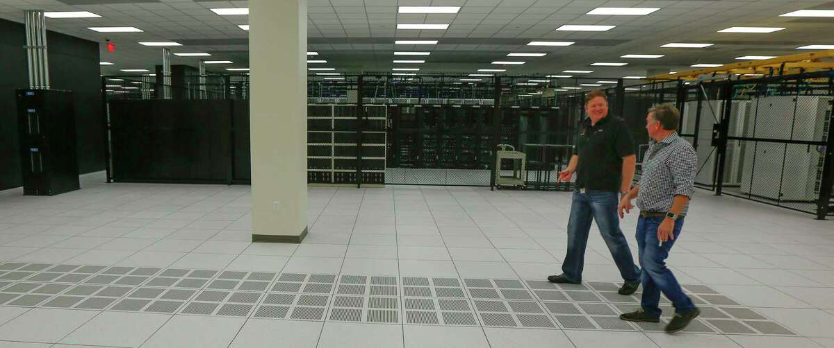 Wesley Klaus, director - data center sales (left) and Will Yokubaitis, vice president of marketing walk through a large server room in Data Foundry - Houston 2 Wednesday, Oct. 23, 2019, in Houston.