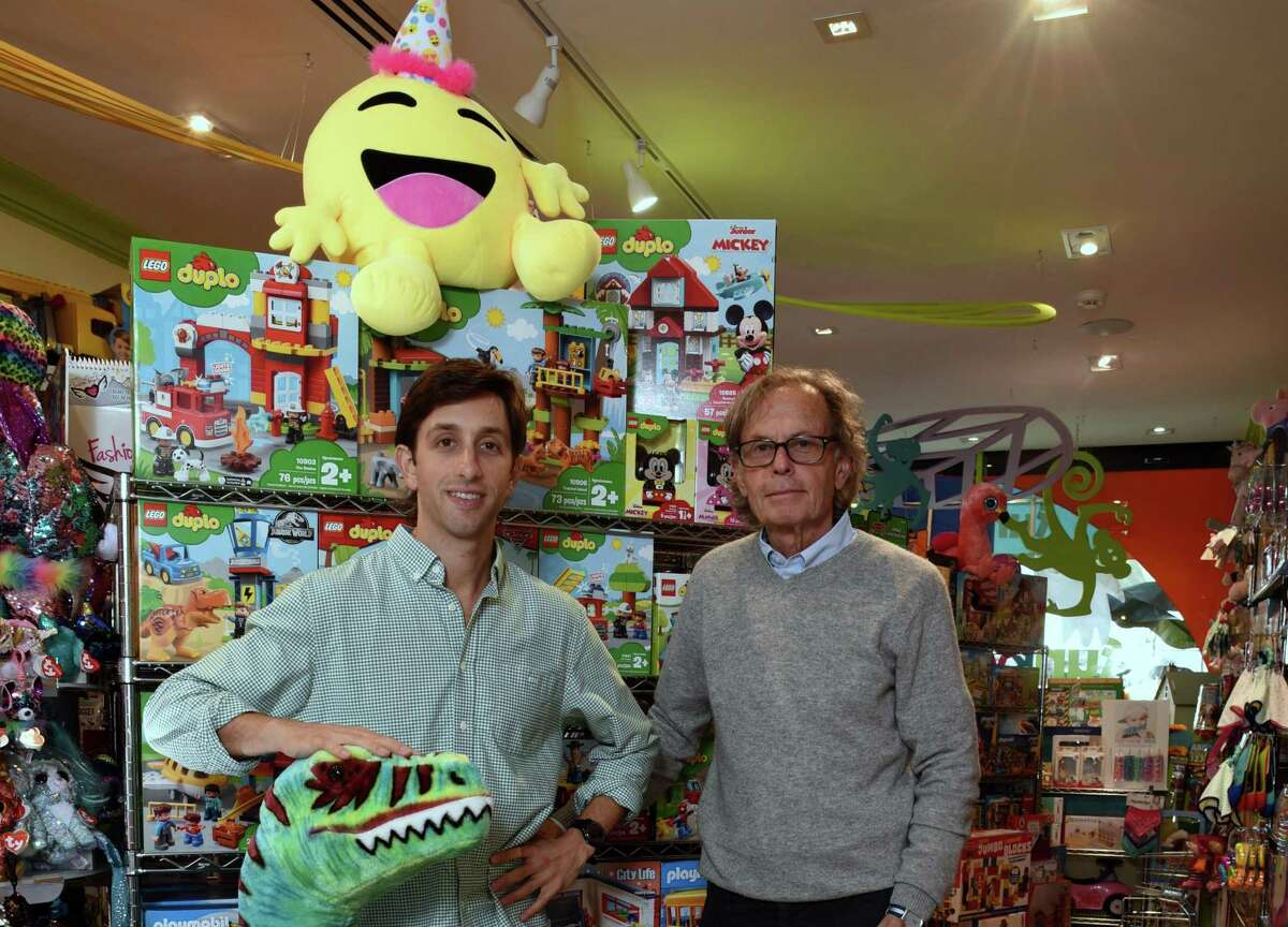 Jared Greenman, left, is the owner of Funky Monkey Toys & Books at 86 Greenwich Ave., in Greenwich, Conn. At right is his father, Stan Greenman, creator and founder of the Noodle Kidoodle chain of toy stores.
