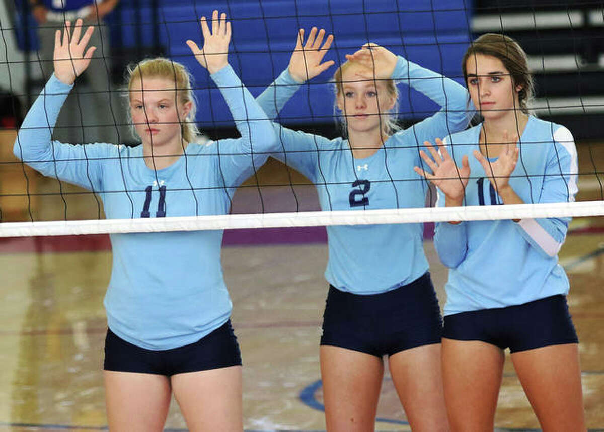 Jersey's (from left) Lauren Rexing, Sally Hudson and Abby Manns wait for the opponent's serve during a match earlier this season at the Roxana Tourney. Rexing and Manns will be among the Panthers honored Thursday on Senior Night when CM visits.