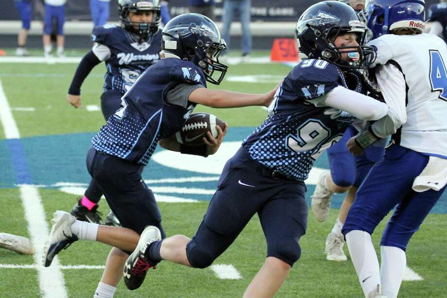 Curtis Jackson throws a blocks for Craig O'Neill, who scored a touchdown on the play for the Wilton 6th grade team in its win over Darien. Photo: Contributed Photo / Wilton Youth Football