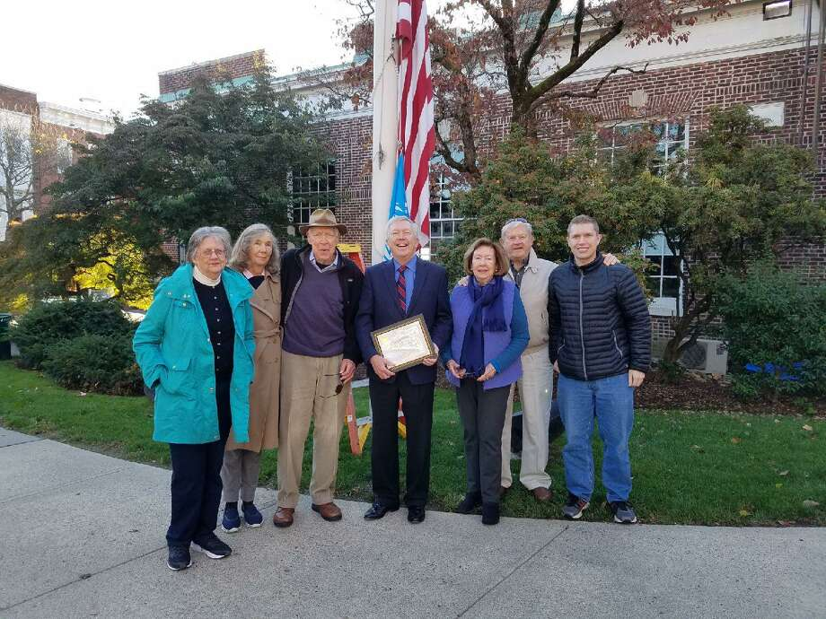 The Town of New Canaan, Connecticut, and the U.N. Committee of New Canaan observed U.N. Day on Thursday, Oct. 24, 2019. Pictured left to right are: U.N. Committee of New Canaan Board Members, Terry Spring, Sara Rehnberg and Pete Runette, who is also the Committee's Co-Chair, New Canaan First Selectman Kevin Moynihan, and Committee Board Members Alice Runette, Alan Haas and Michael Carusi who is also the Committee's Web Designer. Grace Duffield / Hearst Connecticut Media Photo: Grace Duffield / Hearst Connecticut Media