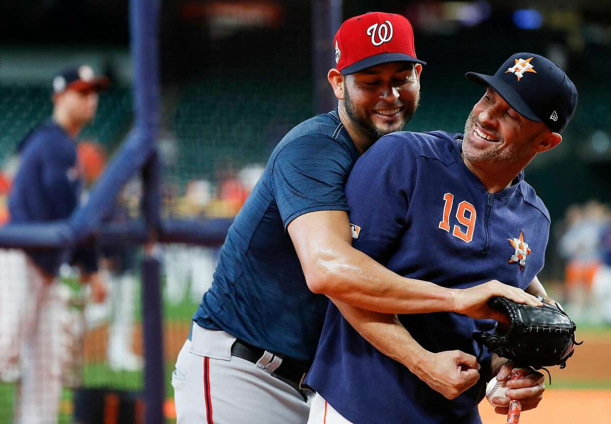 Washington Nationals pitcher Anibal Sanchez, left, and Houston Astros bench coach Joe Espada joke around during batting practice before Game 2 of the World Series at Minute Maid Park in Houston on Wednesday, Oct. 23, 2019.