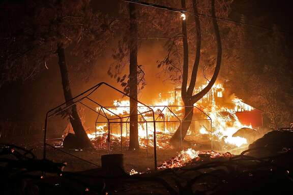 A structure burns at the intersection of Geysers Road and Red Winery Road as the Kincade Fire burns outside Geyserville, Calif., on Thursday, October 24, 2019.
