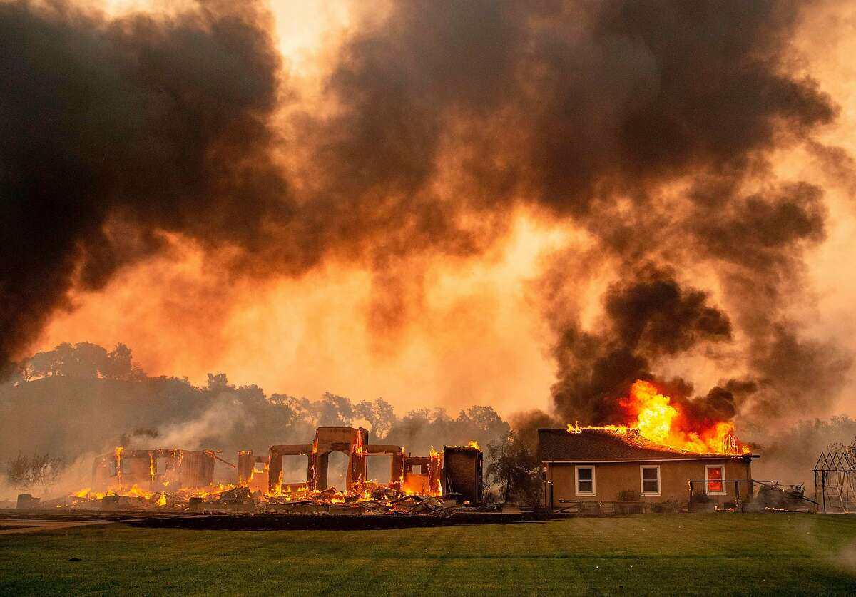 A building is engulfed in flames at a vineyard during the Kincade fire near Geyserville, California on October 24, 2019. - fast-moving wildfire roared through California wine country early Thursday, as authorities warned of the imminent danger of more fires across much of the Golden State. The Kincade fire in Sonoma County kicked up Wednesday night, quickly growing from a blaze of a few hundred acres into an uncontained 10,000-acre (4,000-hectare) inferno, California fire and law enforcement officials said.