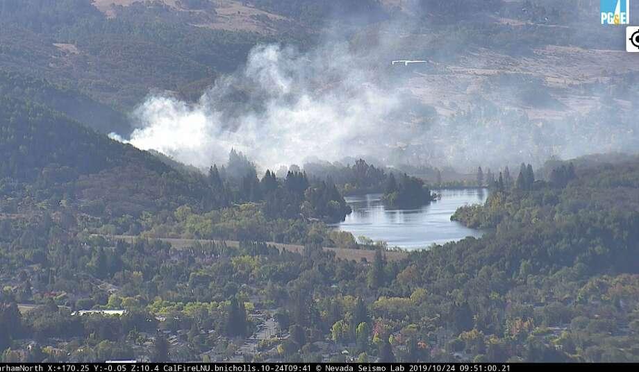 A vegetation fire burns near Spring Lake in Santa Rosa on Thursday, Oct. 24, 2019. Photo: PG&E