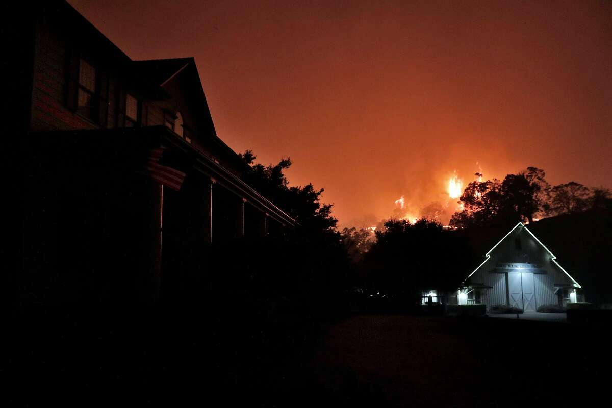 The Robert Young Winery in the path of oncoming flames as the Kincade Fire burns outside Geyserville, Calif., on Thursday, October 24, 2019.