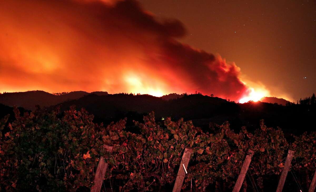 The fire crests the ridge east of Red Winery Road as the Kincade Fire burns outside Geyserville, Calif., on Thursday, October 24, 2019.