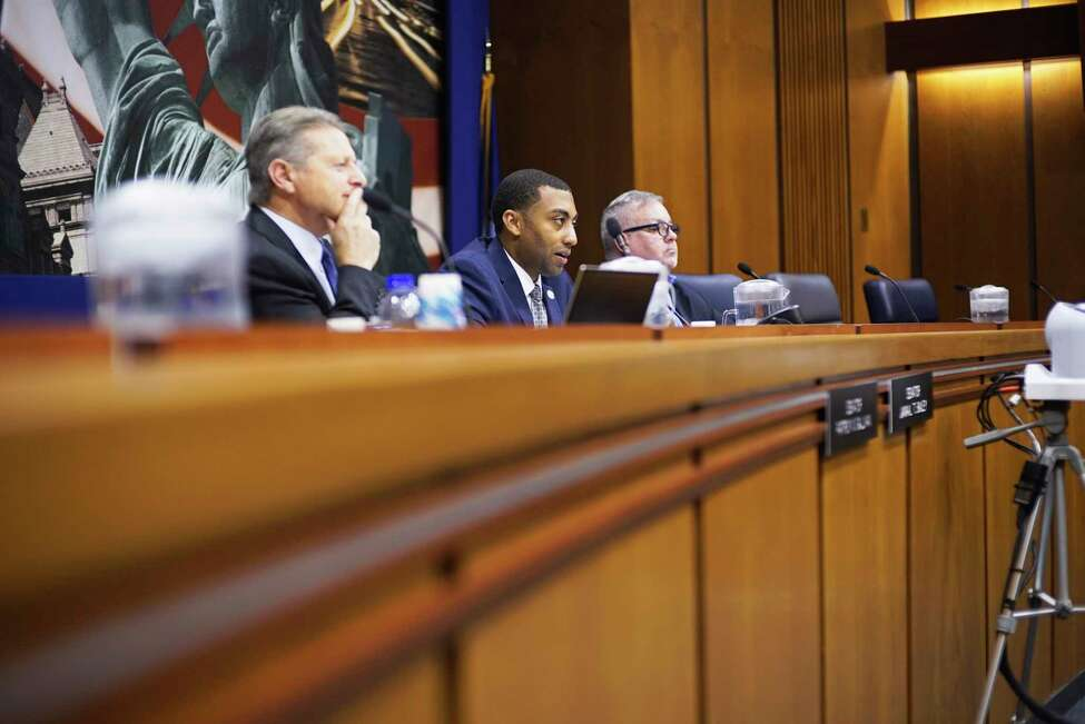Senators Patrick Gallivan, left, and Jamaal Bailey, second from left, and Assemblymember Daniel O'Donnell listen to testimony from representatives from police unions during a public hearing on 50-a at the Legislative Office Building on Thursday, Oct. 24, 2019, in Albany, N.Y. (Paul Buckowski/Times Union)