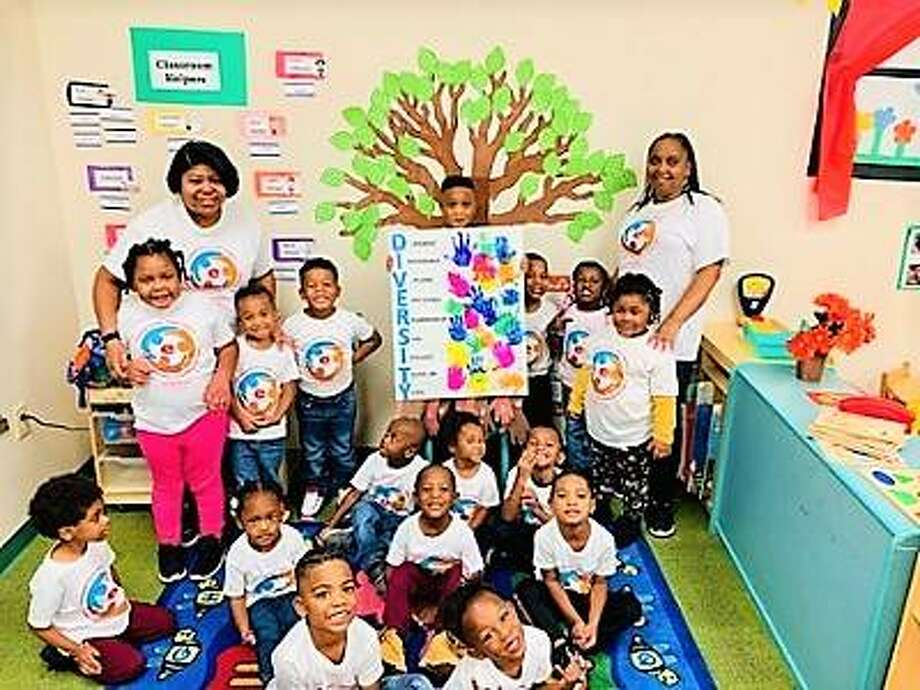 Students from the SIUE Cahokia Head Start Center participated in the University's second annual Diversity Day. Shown are students with teacher Shante Elliott (left) and teaching assistant Tracey Burris (right).
