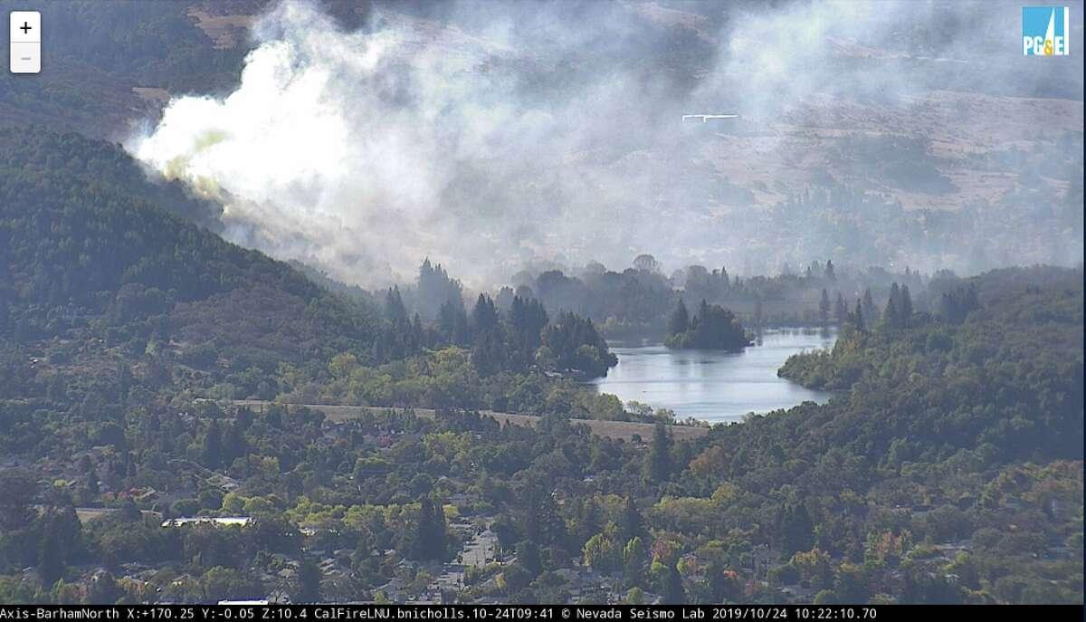 A vegetation fire burns near Spring Lake in Santa Rosa on Thursday, Oct. 24, 2019.