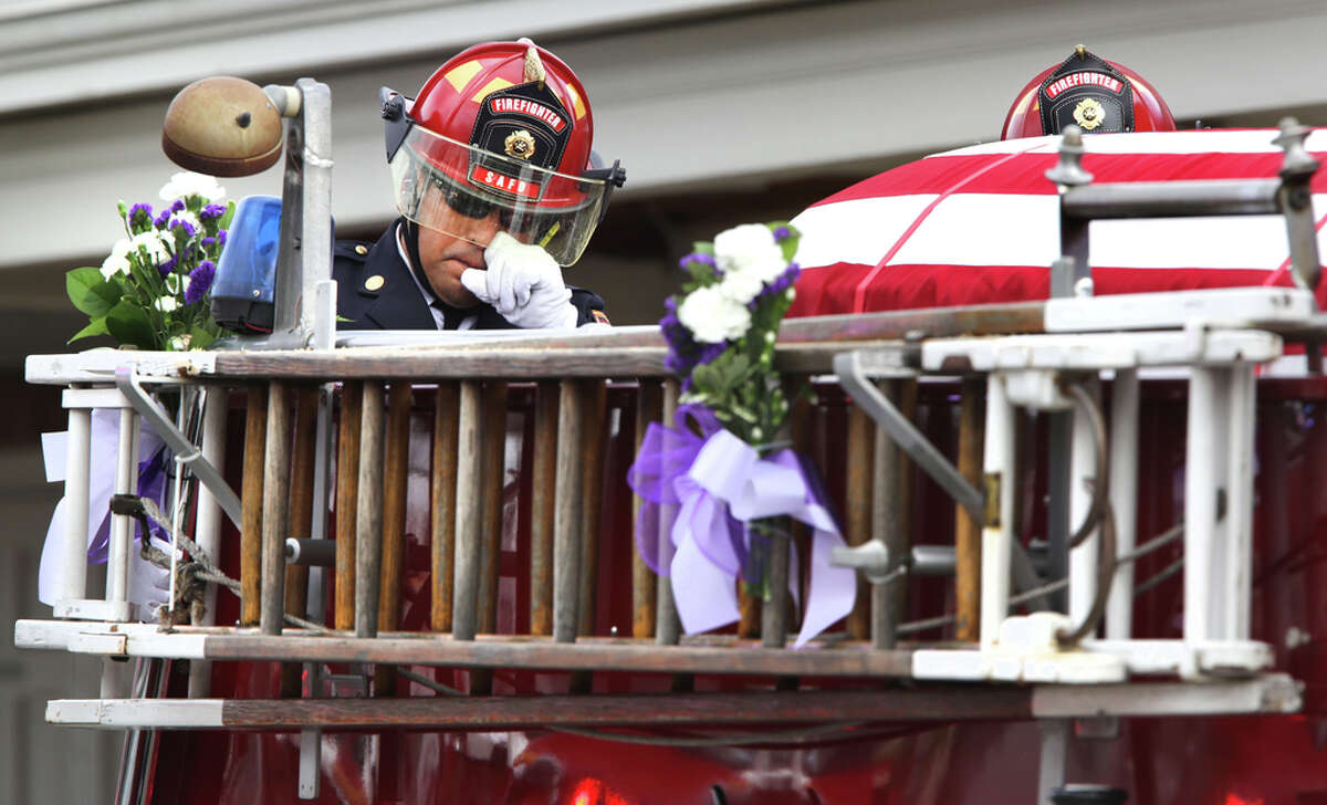 The funeral procession for San Antonio Fire Fighter Greg Garza leaves Porter Loring Mortuary, on Thursday, Oct. 24, 2019.
