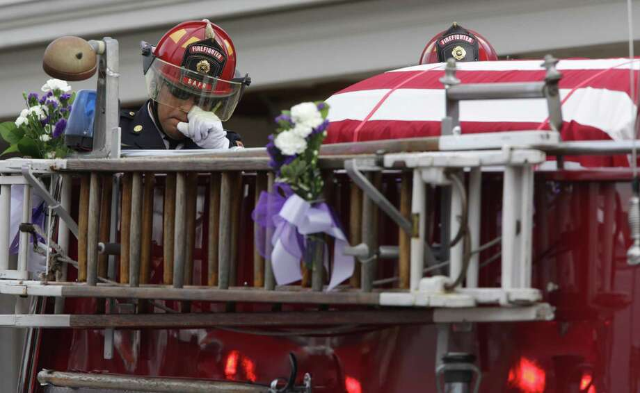 Funeral procession for San Antonio Firefighter Greg Garza leaving Porter Loring Mortuary. Photo: Bob Owen, Staff / San Antonio Express-News / San Antonio Express-News