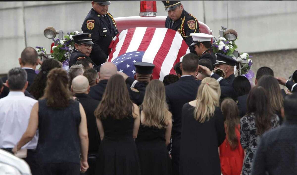 Funeral procession for San Antonio Firefighter Greg Garza leaving Porter Loring Mortuary.
