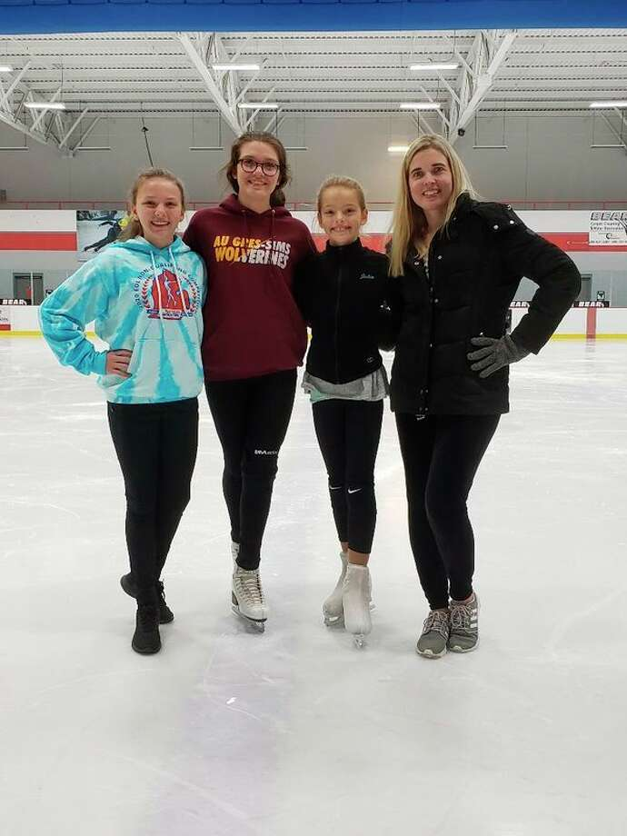 Pictured, from left, are Midland Figure Skating Club skaters Ciarra Franklin, Kyra Barr and Julia Miranda, and MFSCprofessionalTeri Haag, who coaches all three skaters. (Photo provided)
