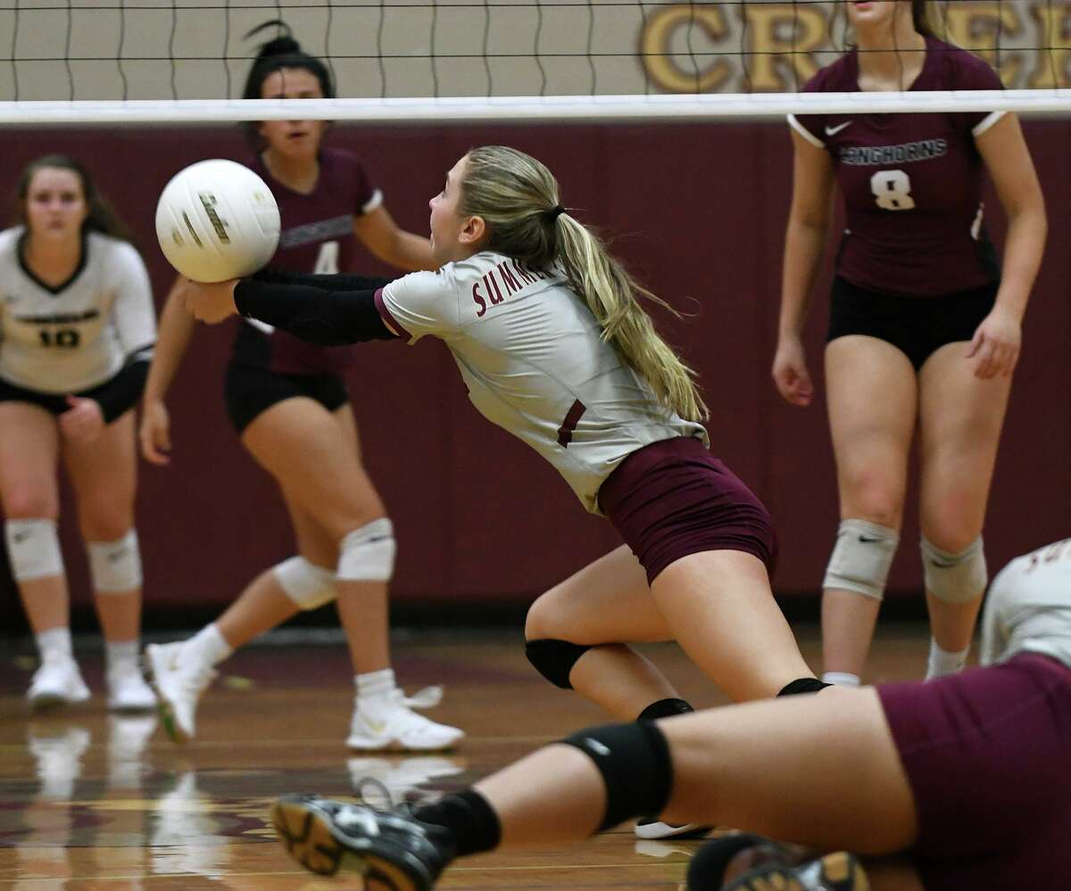 Summer Creek sophomore Jozie Dhayer makes a play against George Ranch during the 2nd set of their non-district matchup at SCHS on August 27, 2019.