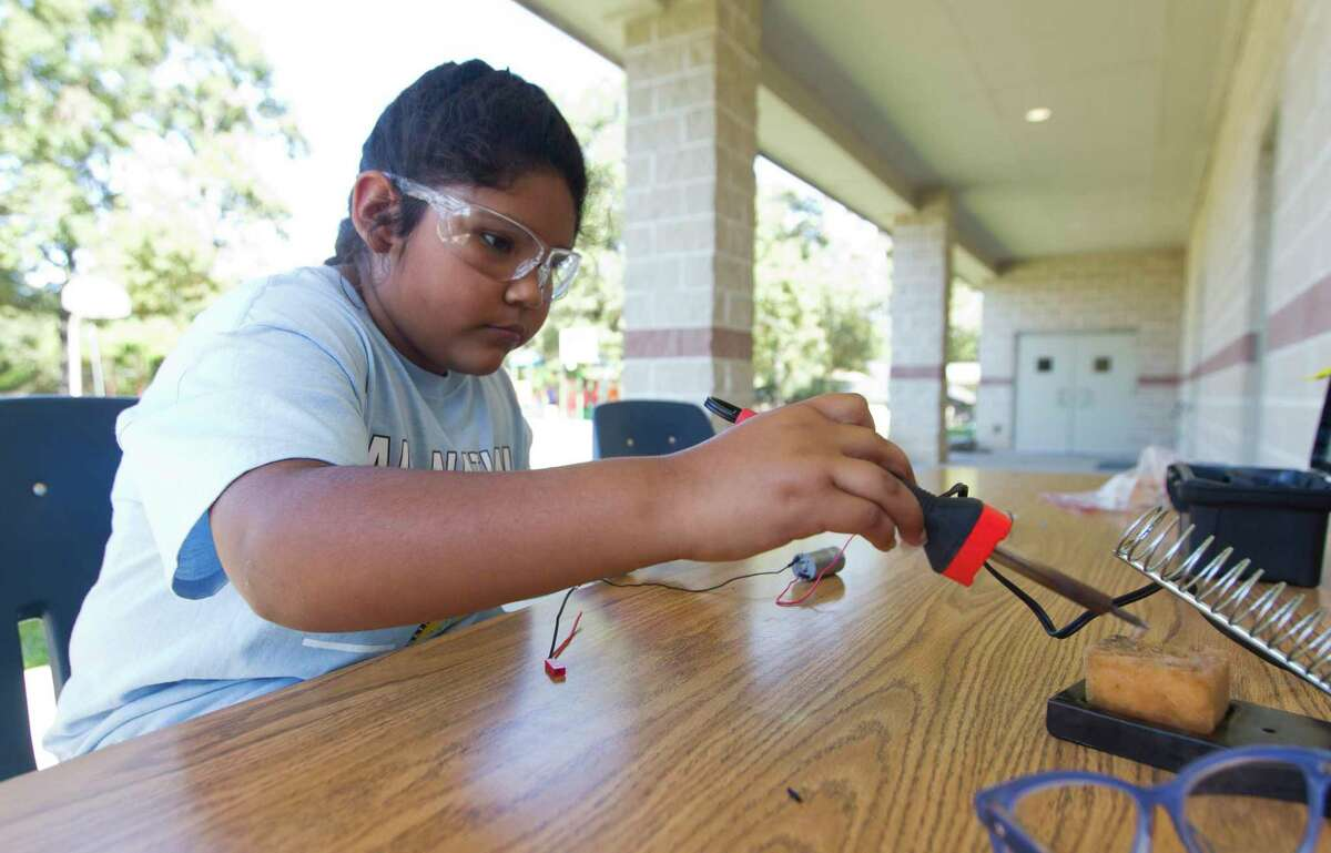 Joyce Aldaba solders wiring at All Nations Community School work on their compeition robot, Thursday, Oct. 24, 2019, in Oak Ridge.
