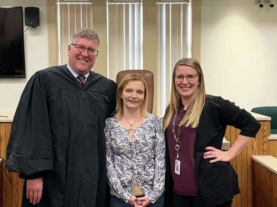 From left, Judge Michael Beale, Jessica Tanner and drug court coordinator Jalene Vickey pose for a photo after Tanner's graduation from the 42nd Circuit Court's Adult Drug Court. (Mitchell Kukulka/Mitchell.Kukulka@mdn.net)