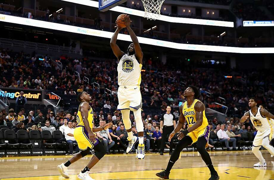 SAN FRANCISCO, CALIFORNIA - OCTOBER 18:  Draymond Green #23 of the Golden State Warriors goes up for a shot on Demetrius Jackson #20 and Devontae Cacok #12 of the Los Angeles Lakers at Chase Center on October 18, 2019 in San Francisco, California. NOTE TO USER: User expressly acknowledges and agrees that, by downloading and or using this photograph, User is consenting to the terms and conditions of the Getty Images License Agreement. (Photo by Ezra Shaw/Getty Images) Photo: Ezra Shaw, Getty Images