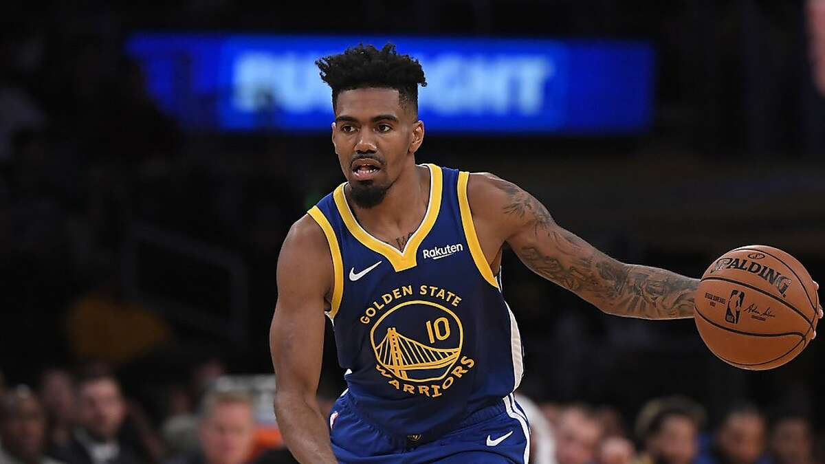 Golden State Warriors guard Jacob Evans dribbles during the second half of a preseason NBA basketball game against the Los Angeles Lakers Monday, Oct. 14, 2019, in Los Angeles. The Lakers won 104-98. (AP Photo/Mark J. Terrill)