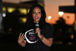 Arhinna Luciano, a survivor of domestic violence, speaks during the Take Back the Night event held as part of Domestic Violence Awareness Month at the Lone Star College Cy-Fair Student Life Amphitheater on Oct. 22, 2019.